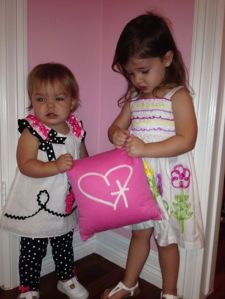Giselle and Gillian with their pink pillow.