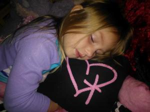 Rayne fell asleep with her pillow.