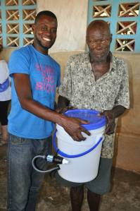 Happy and Thankful... Father and Son...now able to have clean drinking water for their families.